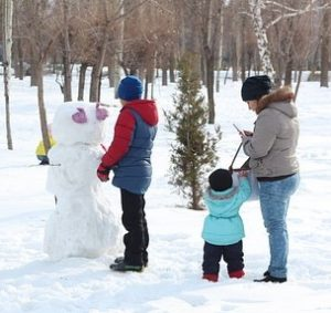 family building a snowman