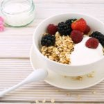 bowl of oatmeal with berries and yogurt