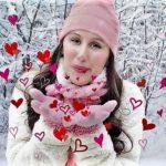 Women in snowy scene blowing cartoon hearts toward the camera