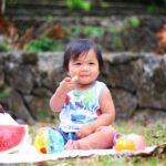 Toddler eating at a picnic
