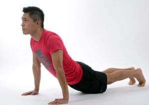 Man stretching back while on hands and feet