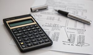 Calculator and reviewing financial paperwork