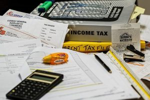 Calculator, Income tax book and receipts to prepare taxes