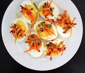 Deviled eggs with julienned vegetables