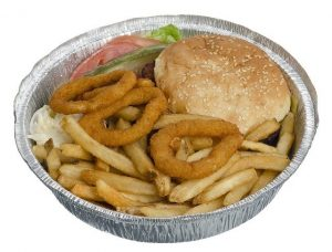 Takeout container with cheeseburger, fries and onion rings.