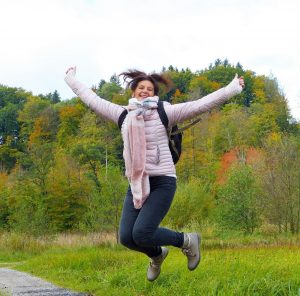 Woman jumping while out walking