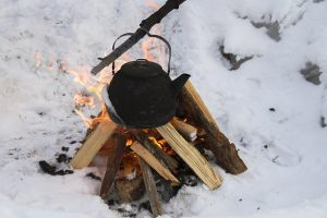 hot water kettle over a campfire