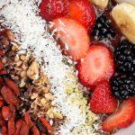 nuts, coconut, strawberries, black berries and sliced bananas