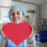 Nurse holding a red heart
