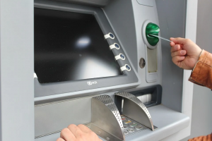 putting credit card into ATM machine