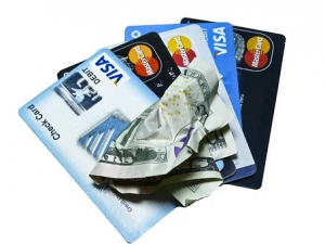 variety of credit cards and a cash bill