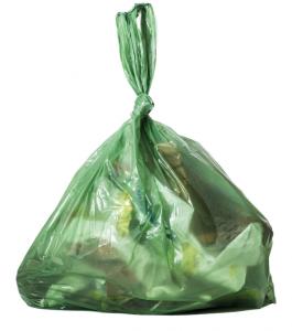 green plastic garbage bag full of garbage